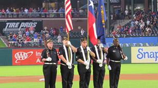 Veterans holding flags at Baseball Park