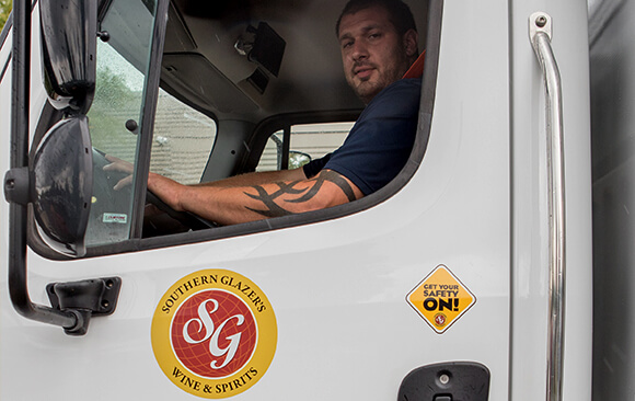 A Southern Glazer's Wine & Spirits delivery driver in a truck