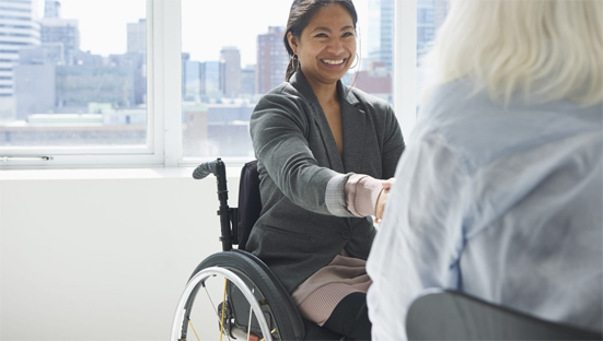 Woman in wheelchair, meeting people