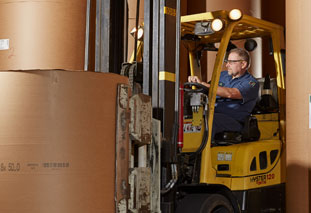 An employee using a forklift