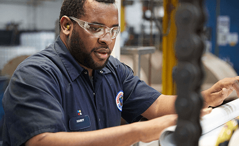 Man in factory wearing safety goggles