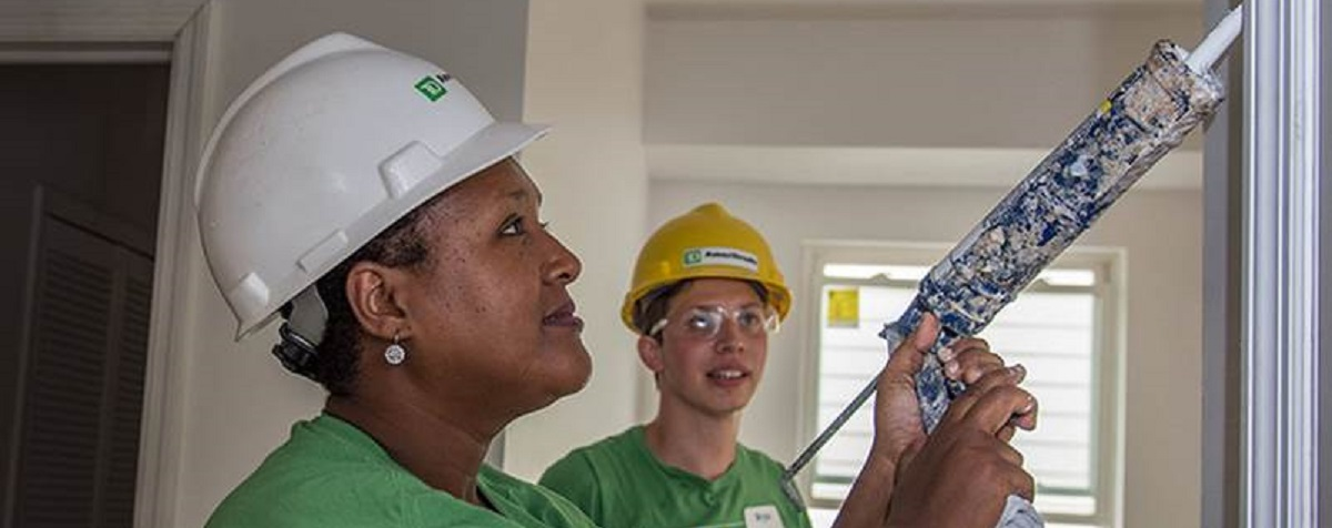 Two TD Ameritrade volunteers doing interior home construction work for charity