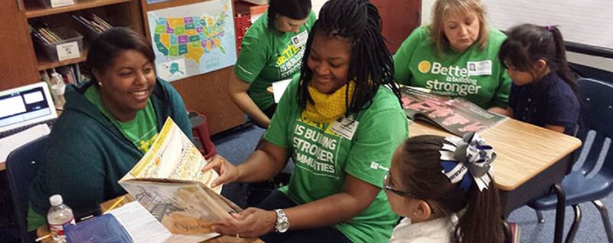 Four TD Ameritrade volunteers reading to elementary-school-aged children