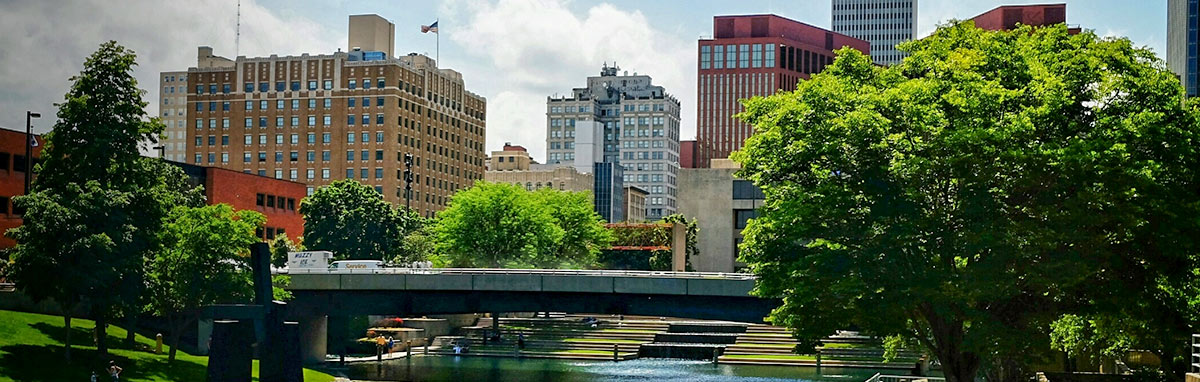 A scenic photo showing the river in downtown Omaha, Nebraska on a warm, sunny day