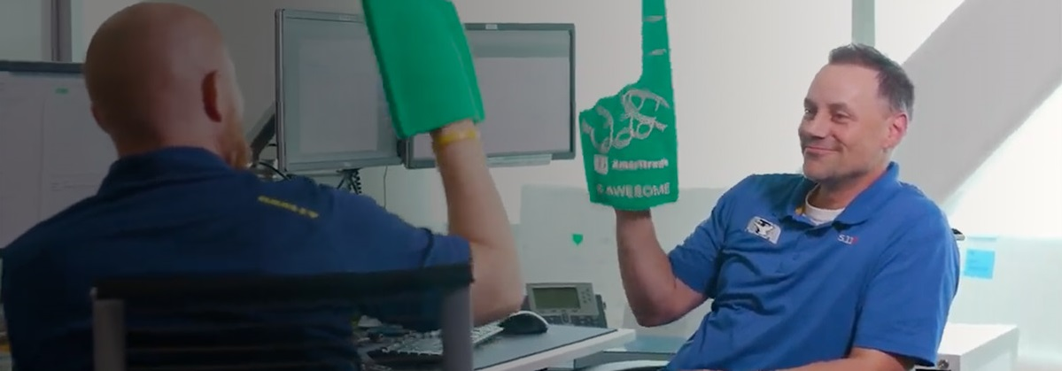 Employees having fun with their novelty foam cheering finger gloves