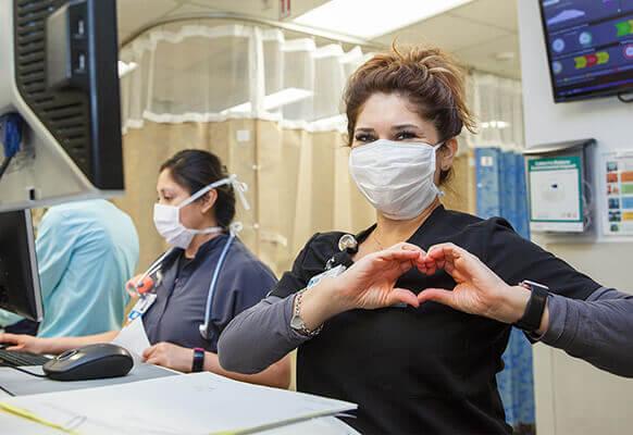 nurse making a heart shape with hands