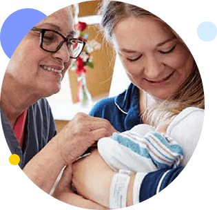 Nurse with mother and newborn
