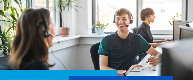 Smiling young people in a call center