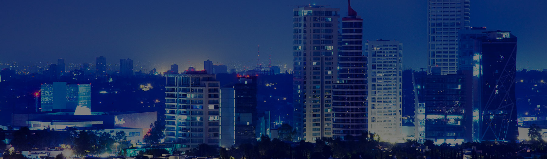A scenic night-time view of a skyline in Mexico City