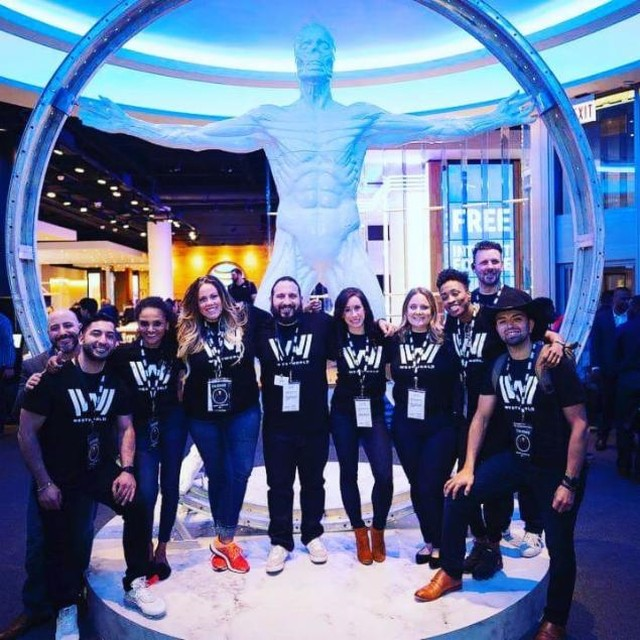 ATT Employees in front of statue