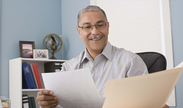Businessman at desk in home office