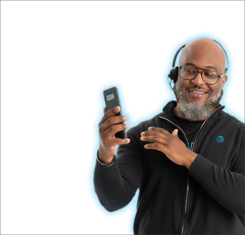 Male employee with headset on looking at a smartphone