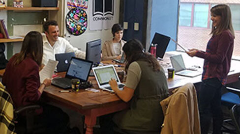 Employees sitting together at a table collaborating