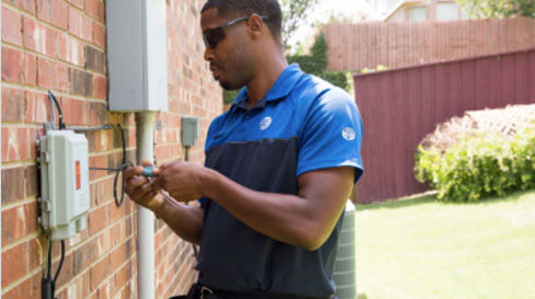 AT&T Technician working on an installation