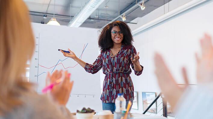 Female employee leading meeting