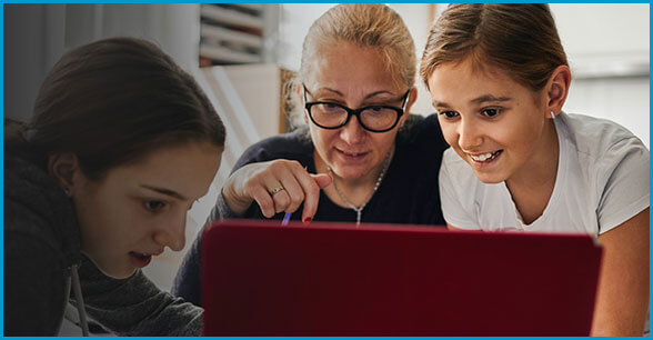 Woman looking at laptop with two children