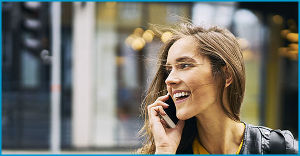 Person speaking on cell phone and smiling