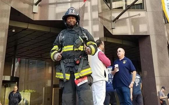 Willie Wilson wearing firefighter gear