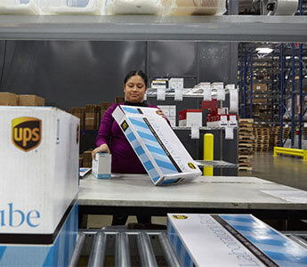 Woman looking carefully at UPS package while working