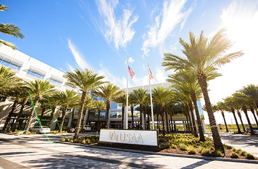 The USAA office sign showing the entrance to the Tampa office with palm trees all around it