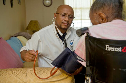 A nurse takes a patient's blood pressure