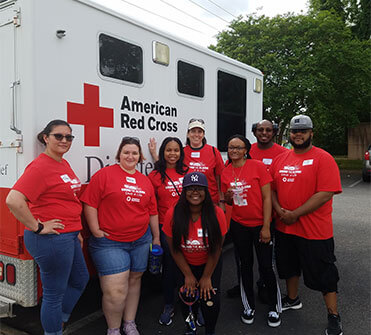 Employees posing for a picture after volunteering for the American Red Cross