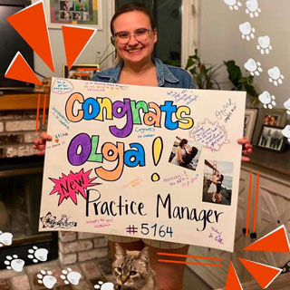 Thumbnail: A lady showing banner saying congrats