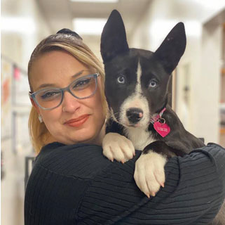 Thumbnail: A lady posing with a black and white dog
