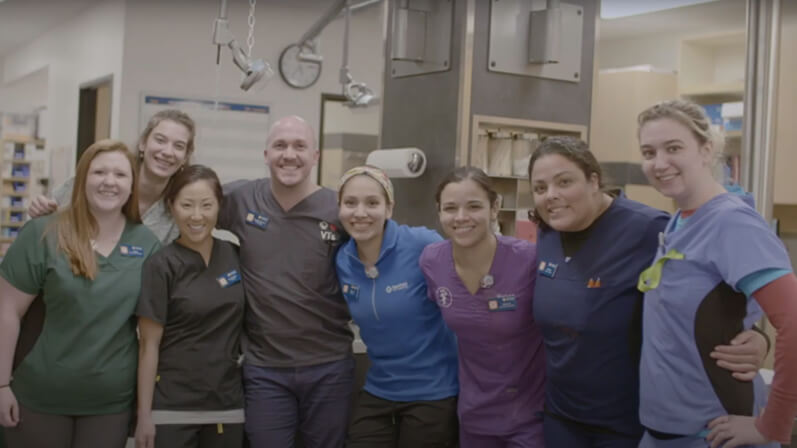 Employees smiling for a group photo