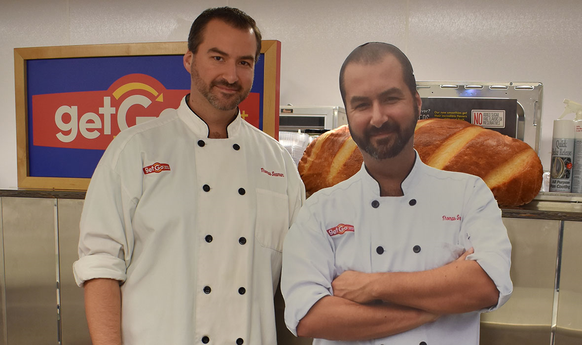 Chef Tom with a cardboard cutout of himself