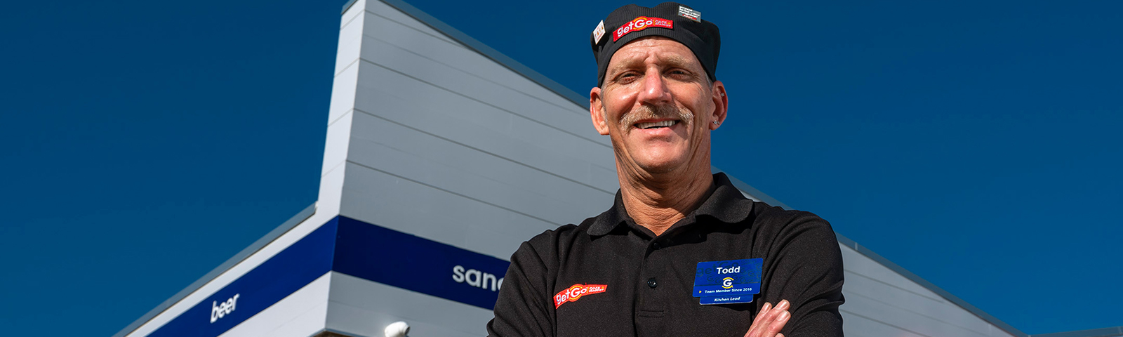 Man outside of building in work uniform