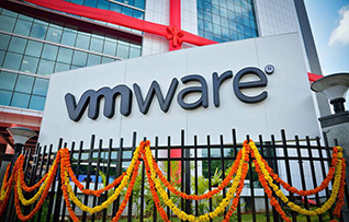 VMware sign in front of a new building with a bow.