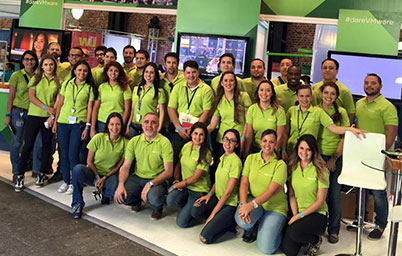 Group of VMware employees in lime green shirts.