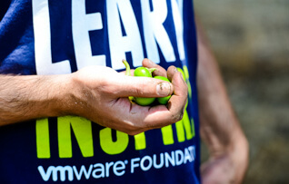 Man in VMware Foundation shirt holding seeds