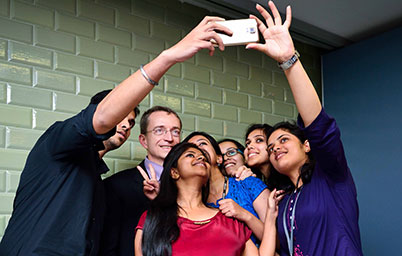 Group of VMware employees take a selfie.