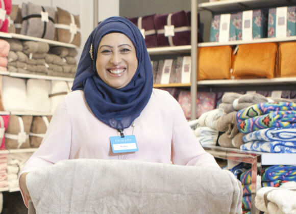 Bushra working in a Primark store