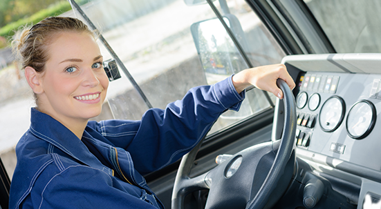 Woman smiling with hand resting on steering wheel
