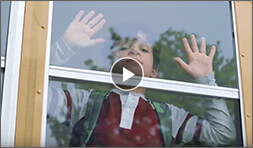 video thumbnail young boy looking out bus window