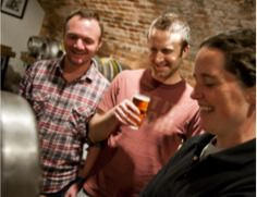 Pub & Carvery Image of three people drinking beer