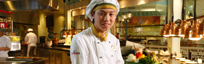 Smiling chef in the kitchen at Hong Kong Disneyland Resort