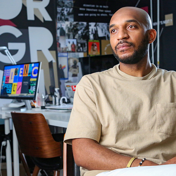 Capital One associate sits at desk and talks about Black History Month