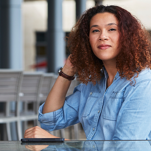 Tia, a Capital One Tech associate, sits outside and talks about her day in the life at Capital One