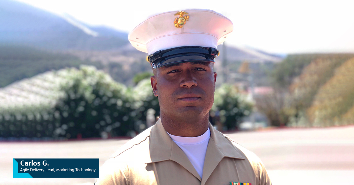 Capital One Military Veteran associate Carlos G., Agile Delivery Lead, Marketing Technology, stands outside in his military uniform