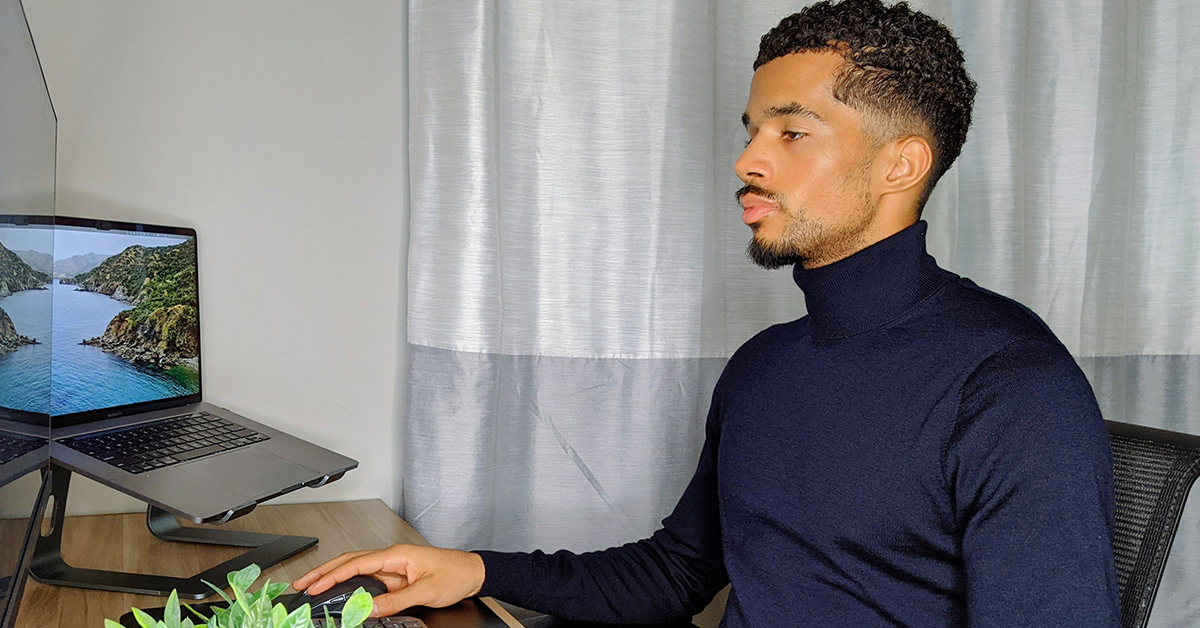 Capital One TDP associate, Carlton, works from home on his computer