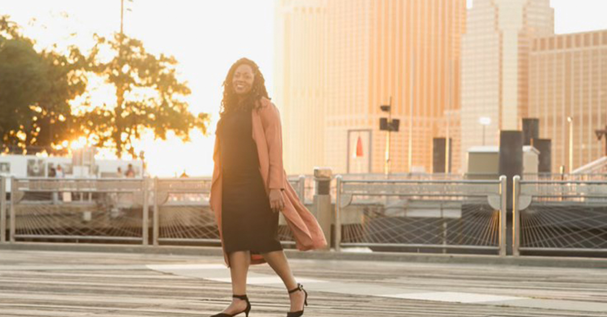 Cat Posey, a Capital One Machine Learning leader, stands at sunset and talks about women in Tech at Capital One