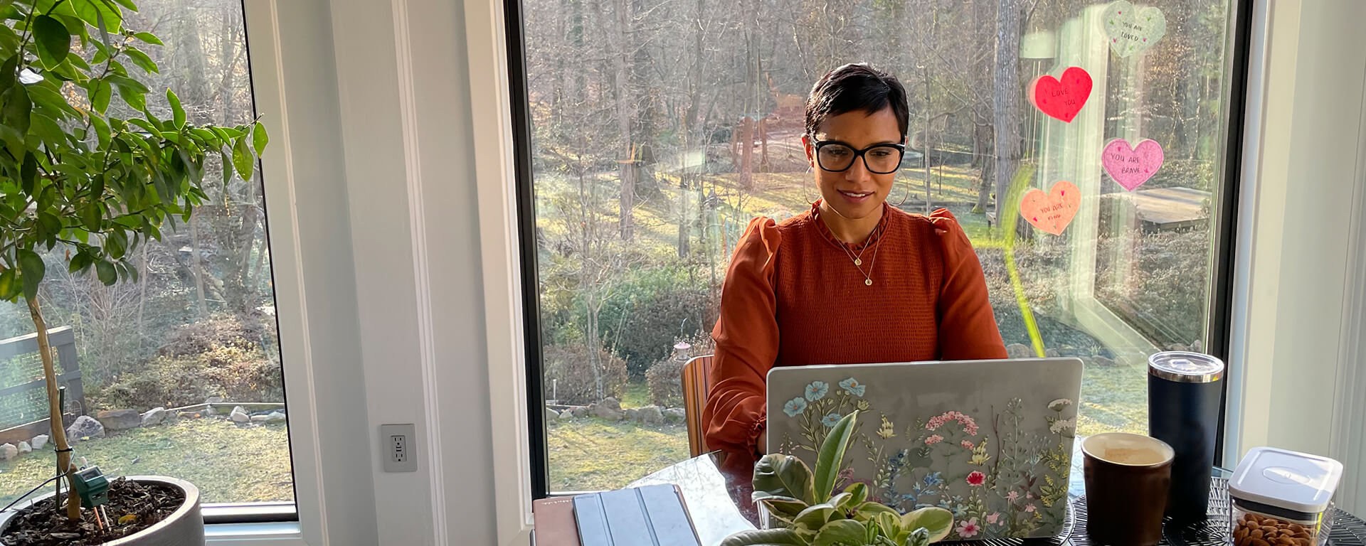 Capital One associate working at her laptop at home for the Catalyst Rotational Program