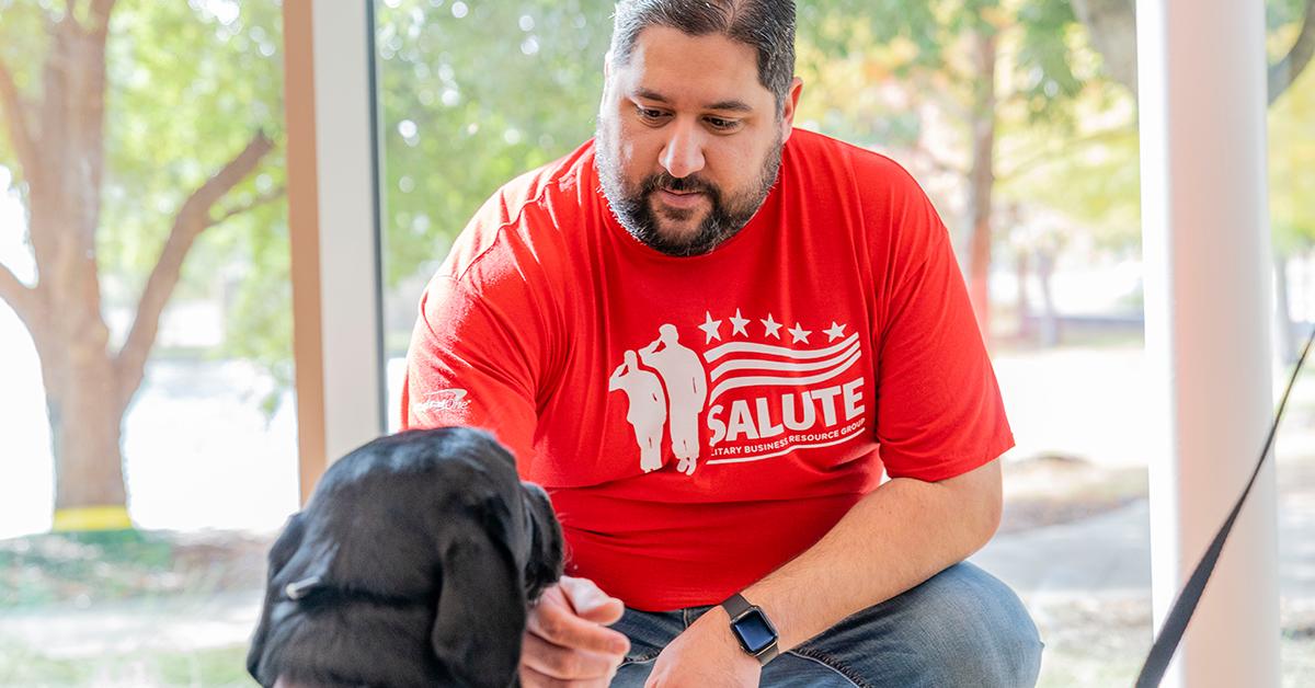 Capital One associate kneels to pet Veterans