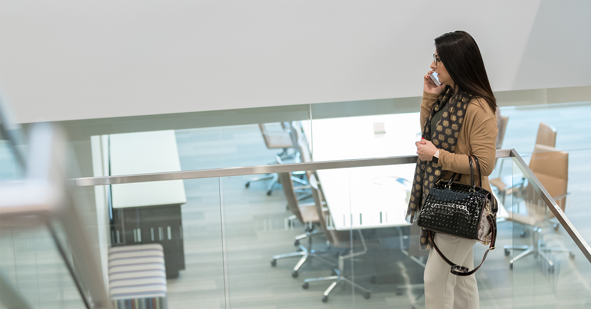 Woman talks on phone in Capital One office
