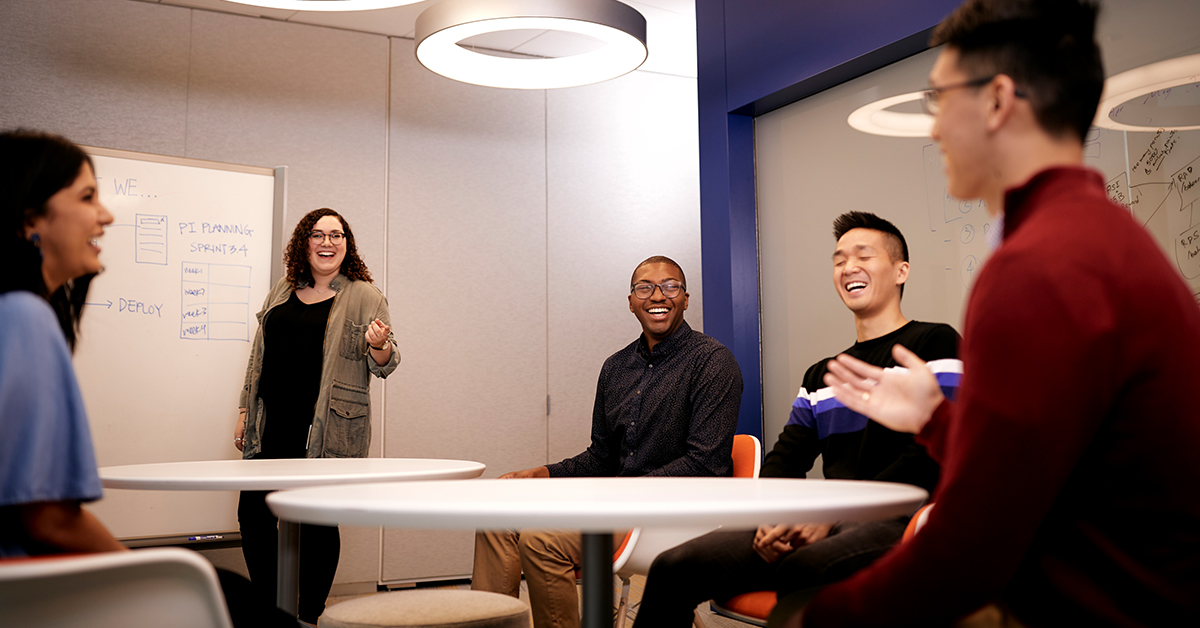 Capital One student and grad associates collaborate in a meeting room