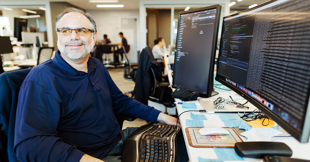 Capital One Software Engineer sits at his desk